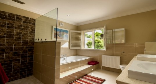 Bathroom with bathtub and rain shower